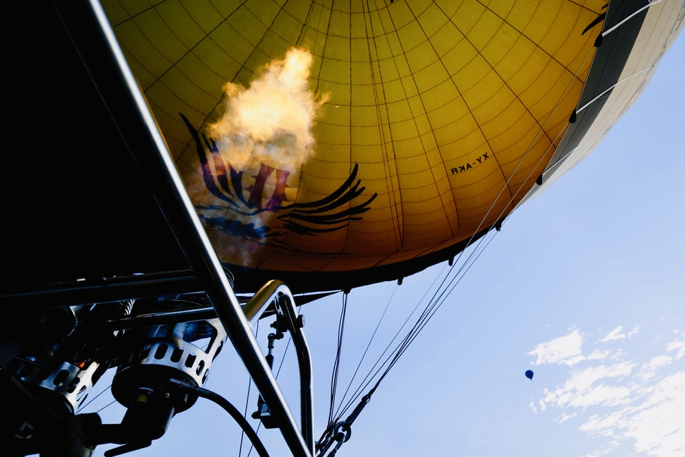 lighted air balloon during daytime