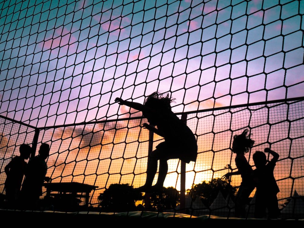 silhouette of playing girl
