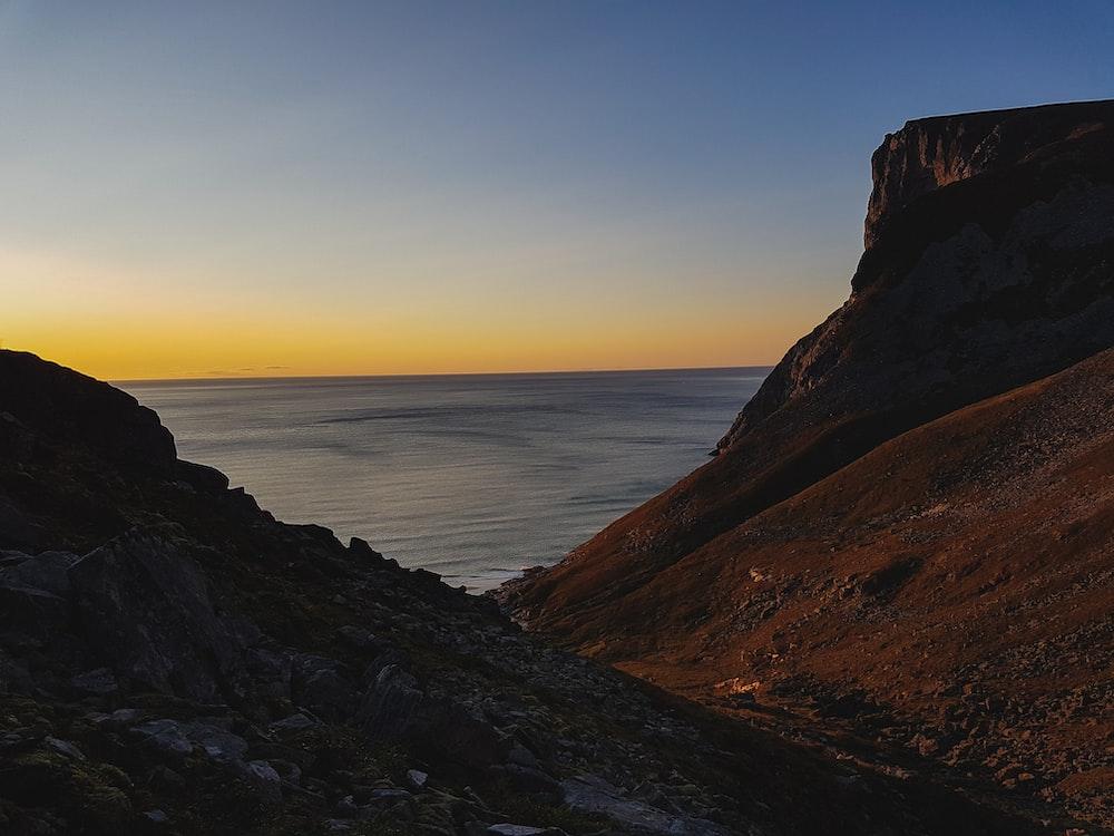 brown cliffs near ocean