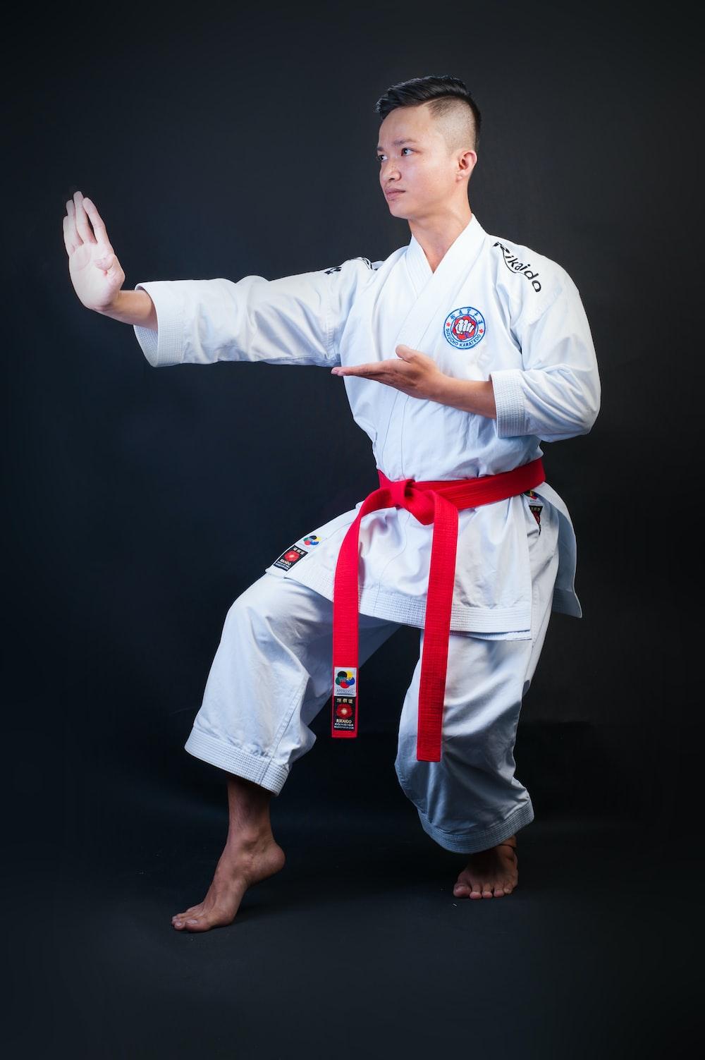 man standing wearing white karate gi