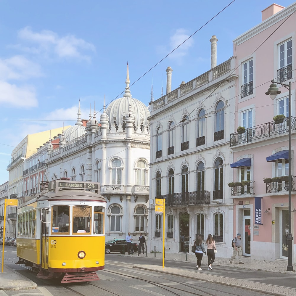 yellow tram on road during daytime