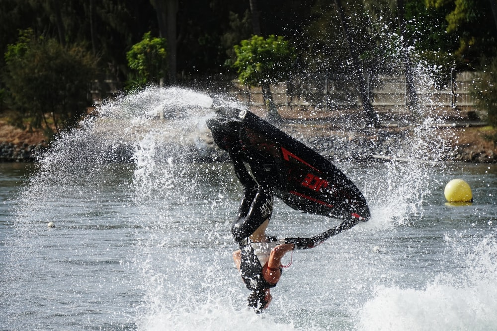 person riding on personal watercraft