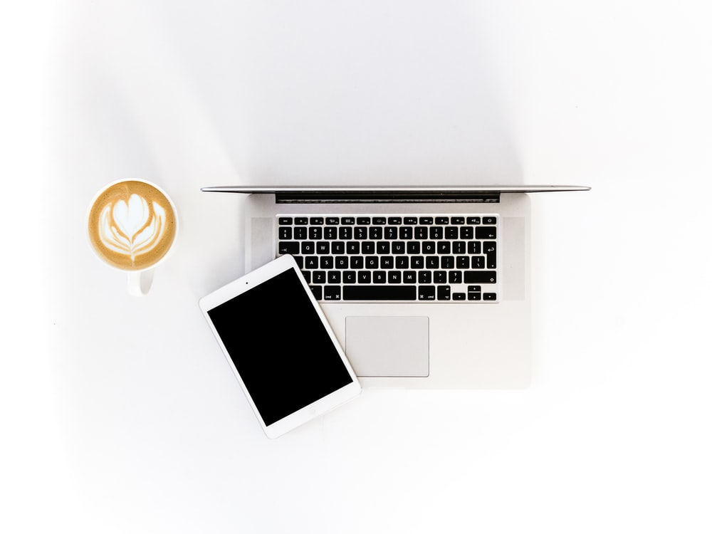 flat-lay photography of iPad and MacBook