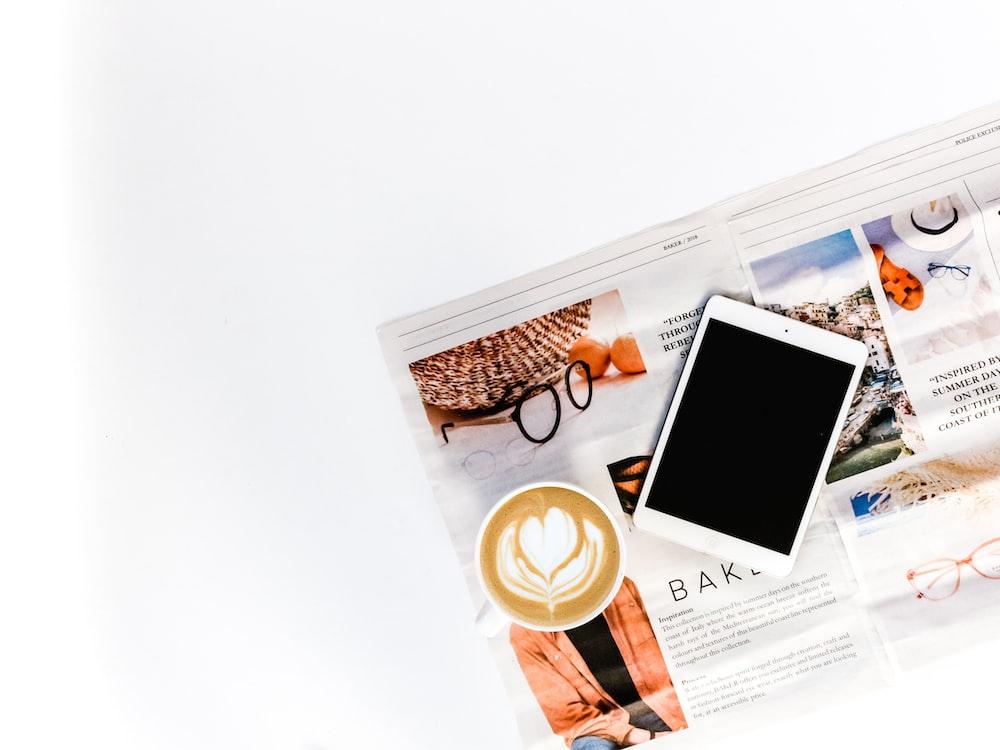 white iPad and cappuccino