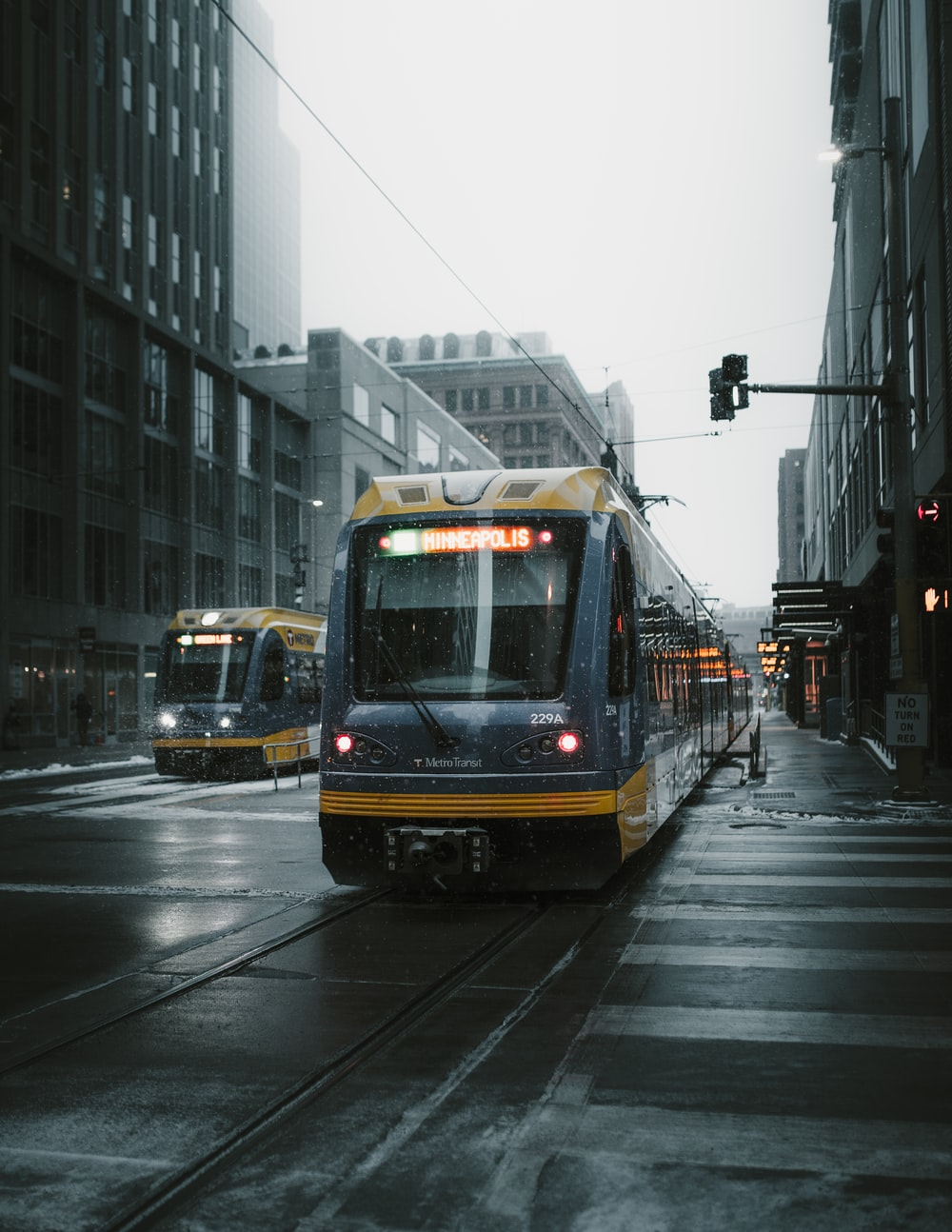 yellow and gray bus on street during cloudy daytime