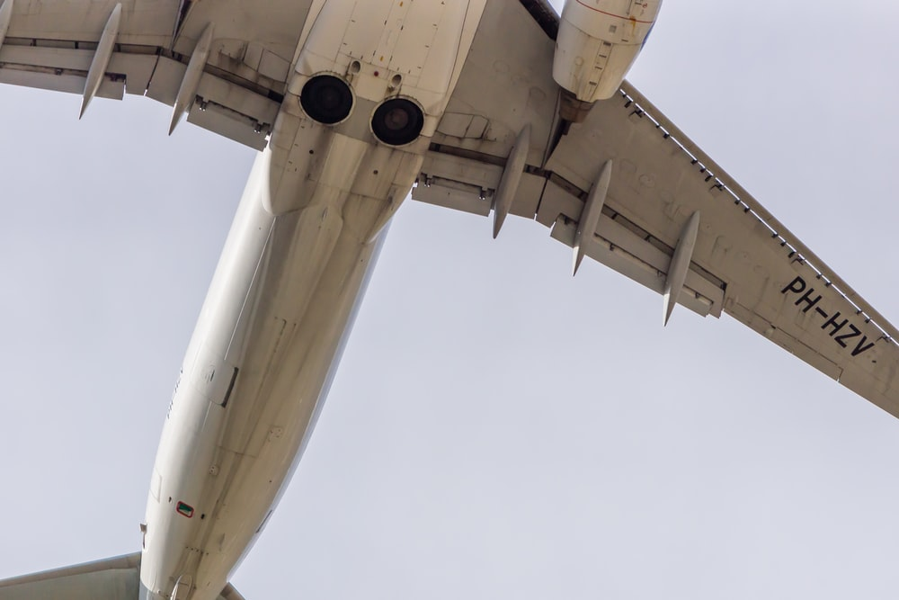 low angle photography of white passenger plane