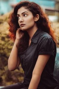 woman wearing black blouse