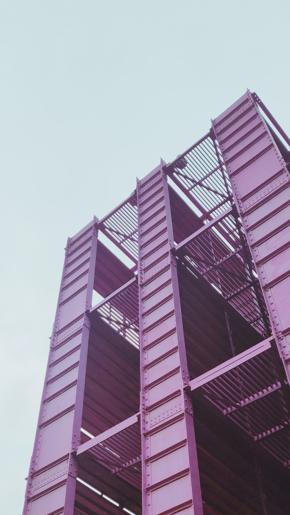pink metal high rise building under white sky