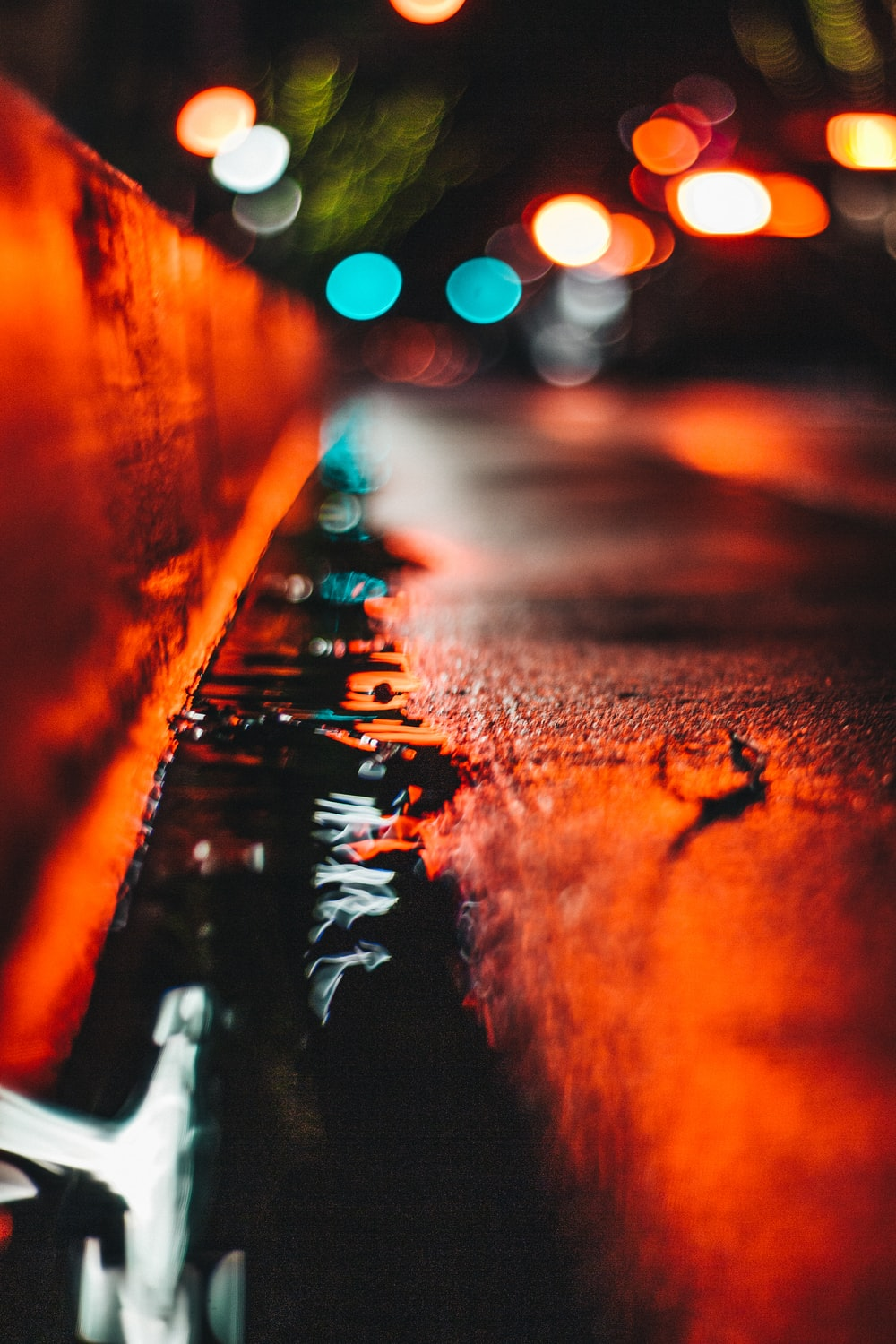 selective focus photography of water beside road