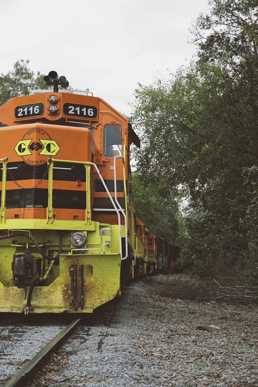yellow and orange locomotive on rails