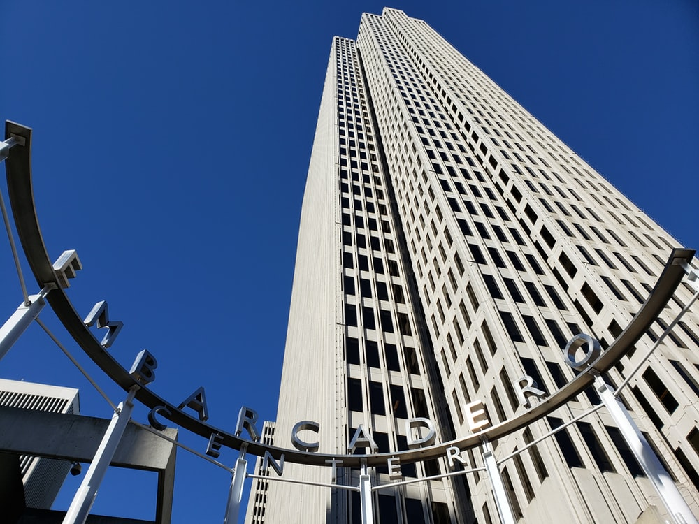 Embarcadero sign across white tall building