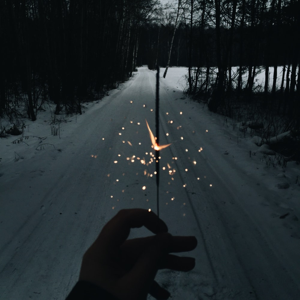 person using sparkler during nighttime