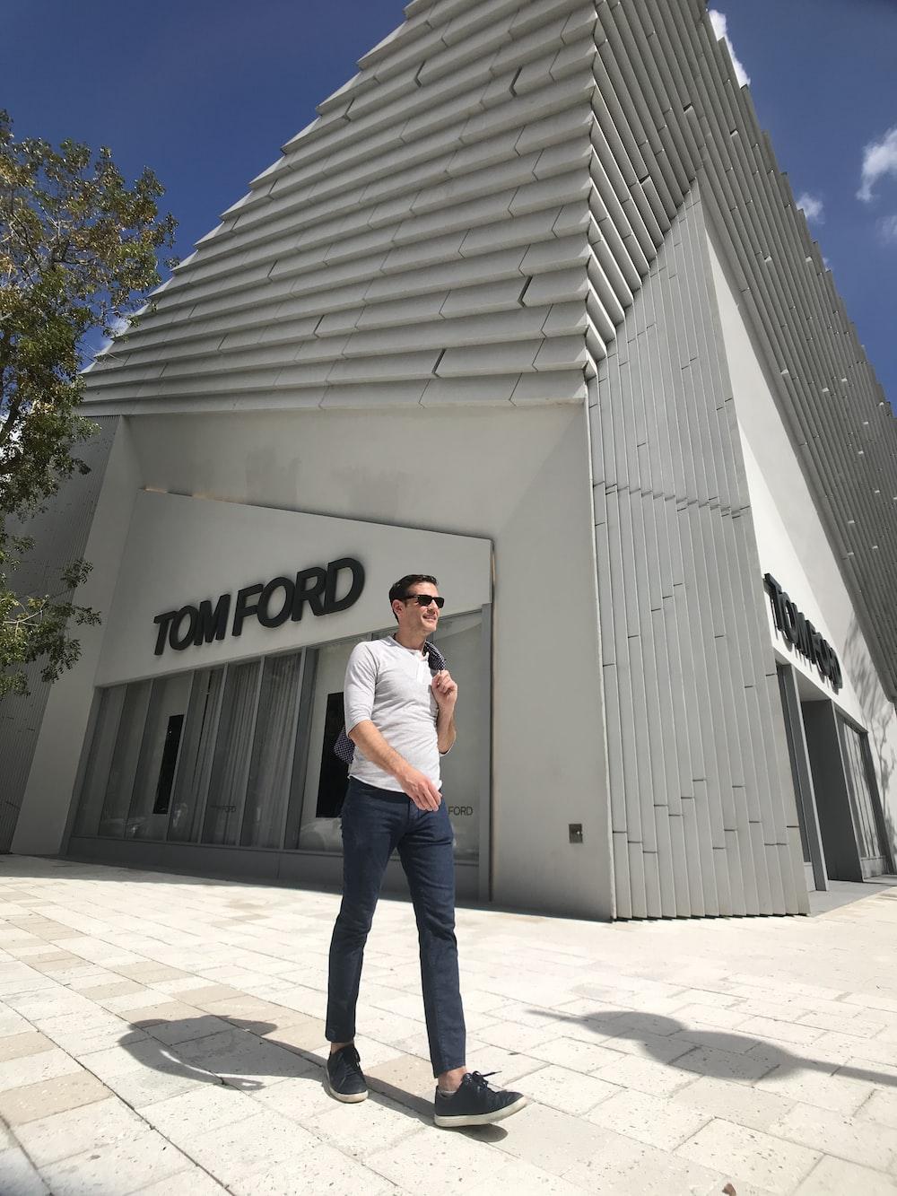 man walking near Tom Ford building