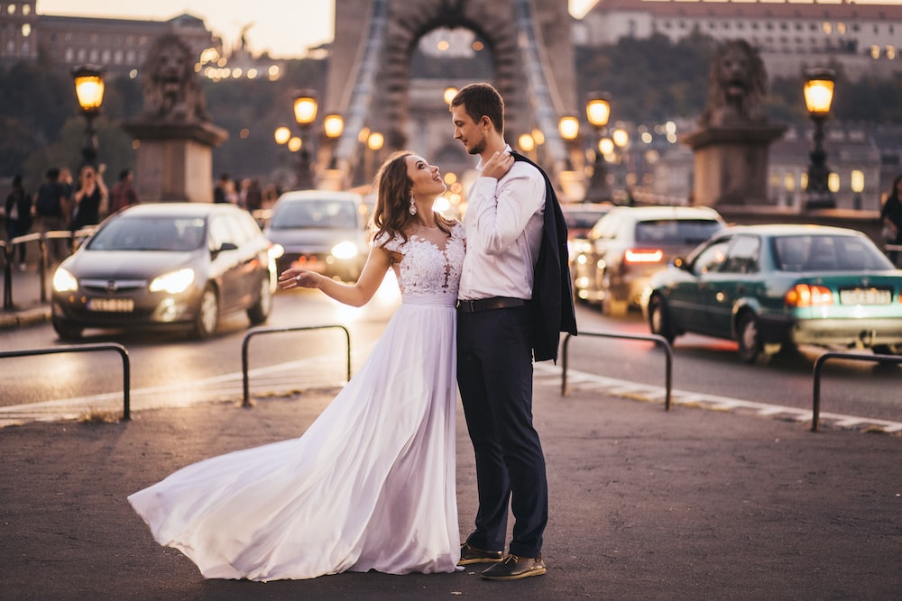 newly wed standing on street during day time