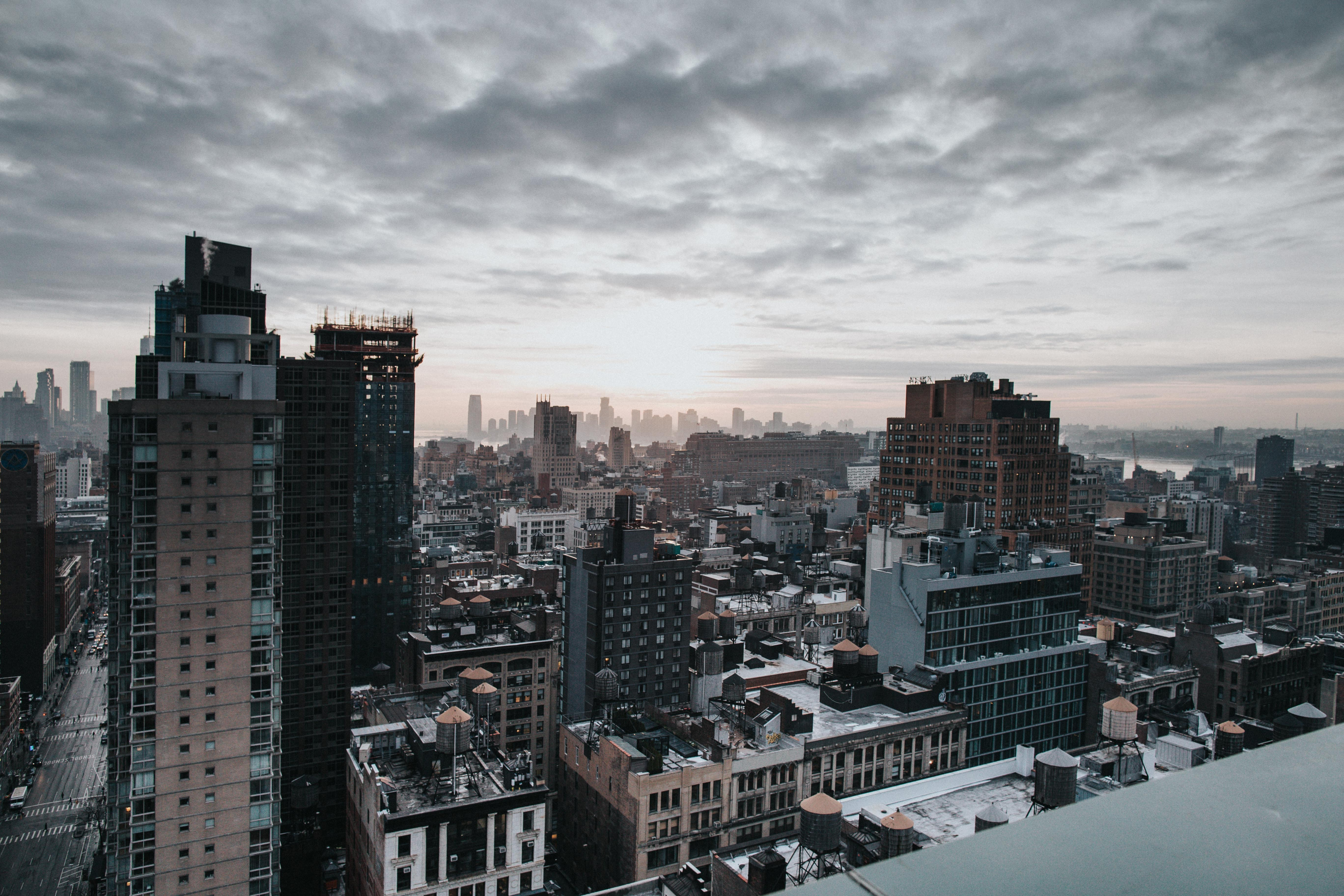 aerial photo of city buildings under cloudy sky