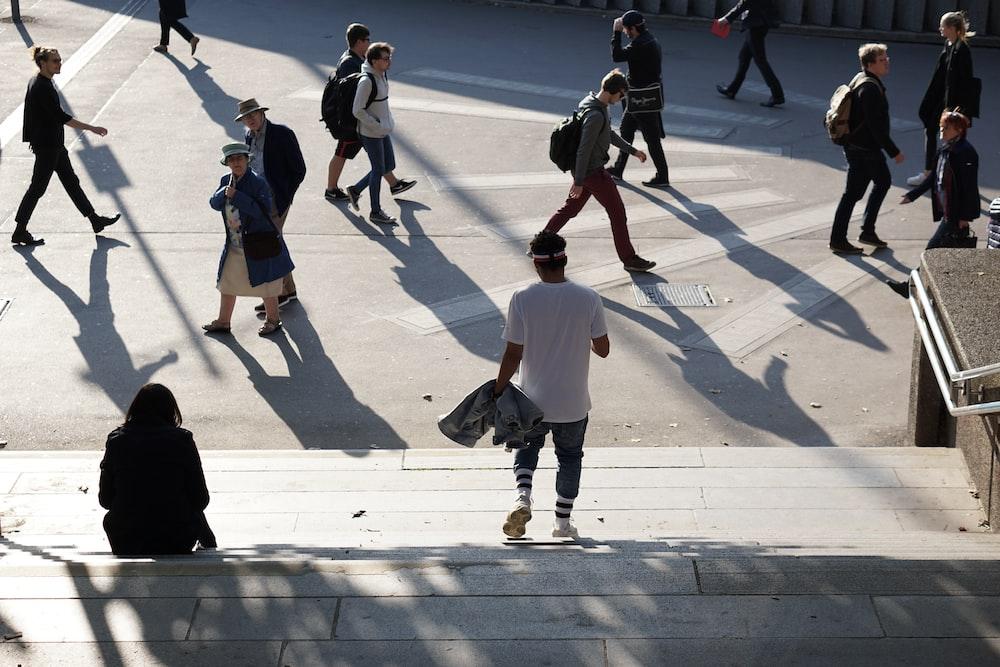 people walking in road during daytime