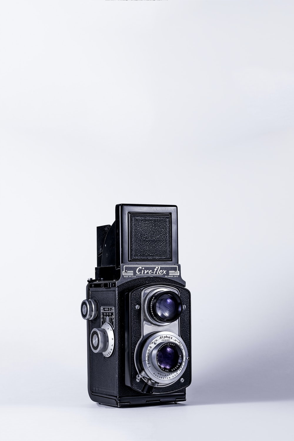 Black and gray camera on white surface