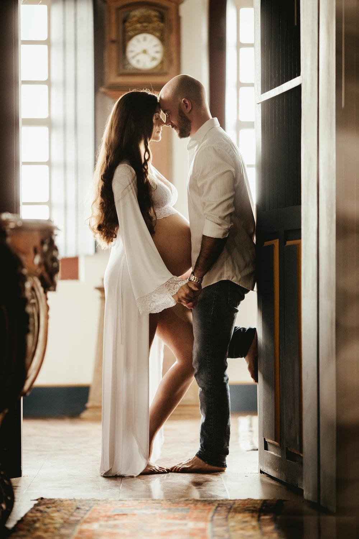 couple standing near door