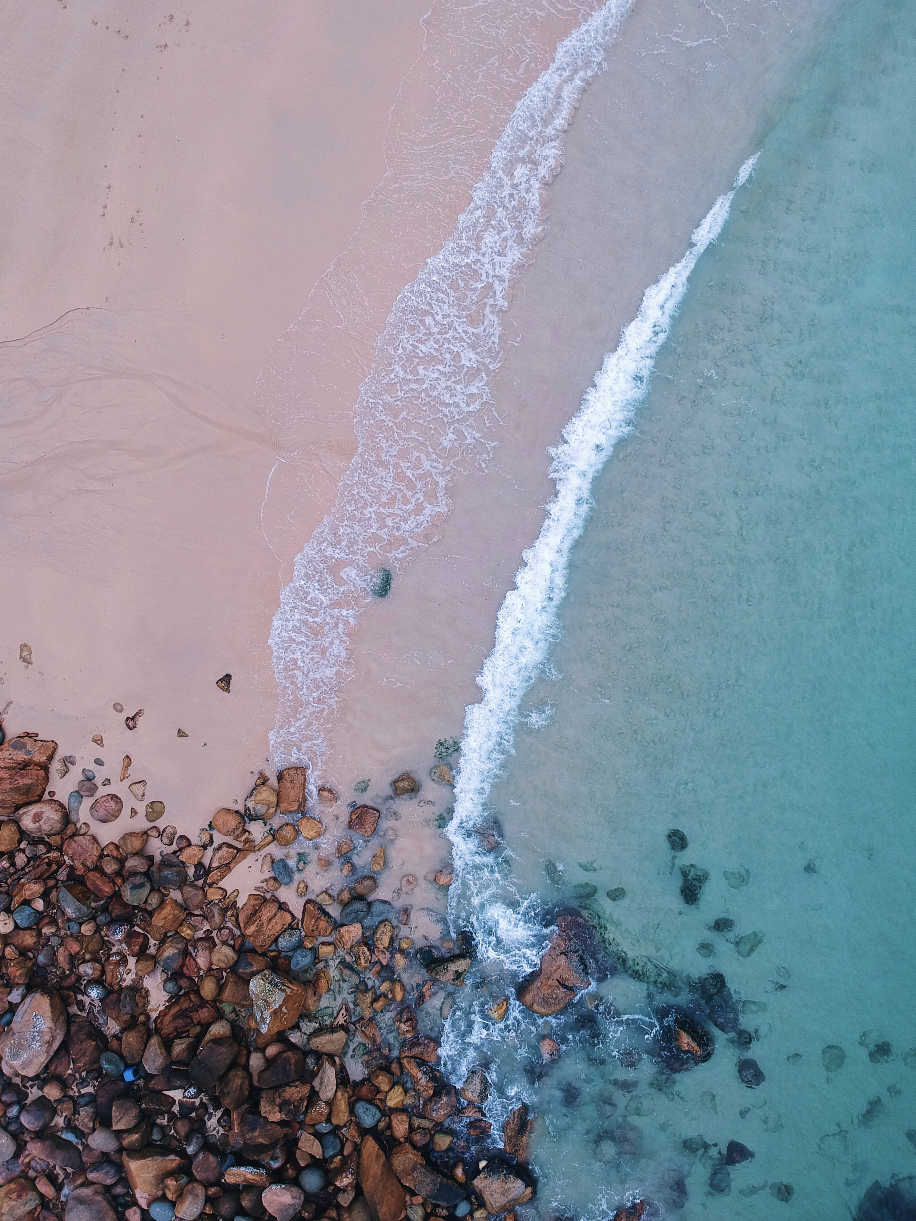 aerial view photography of stones on seashores