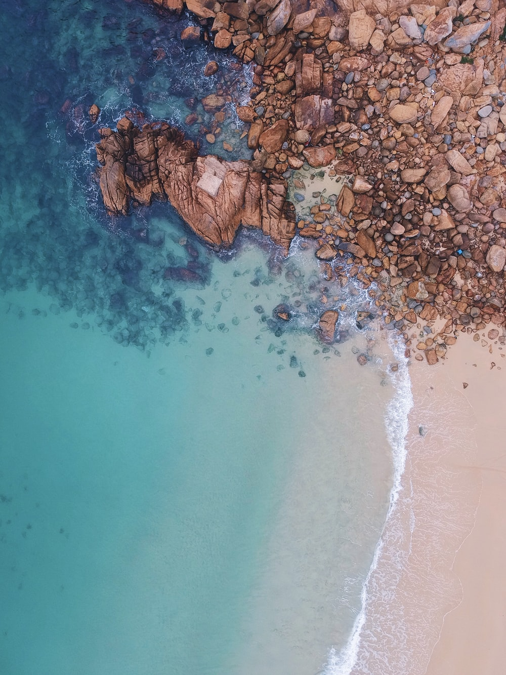 aerial view of rocks near body of water