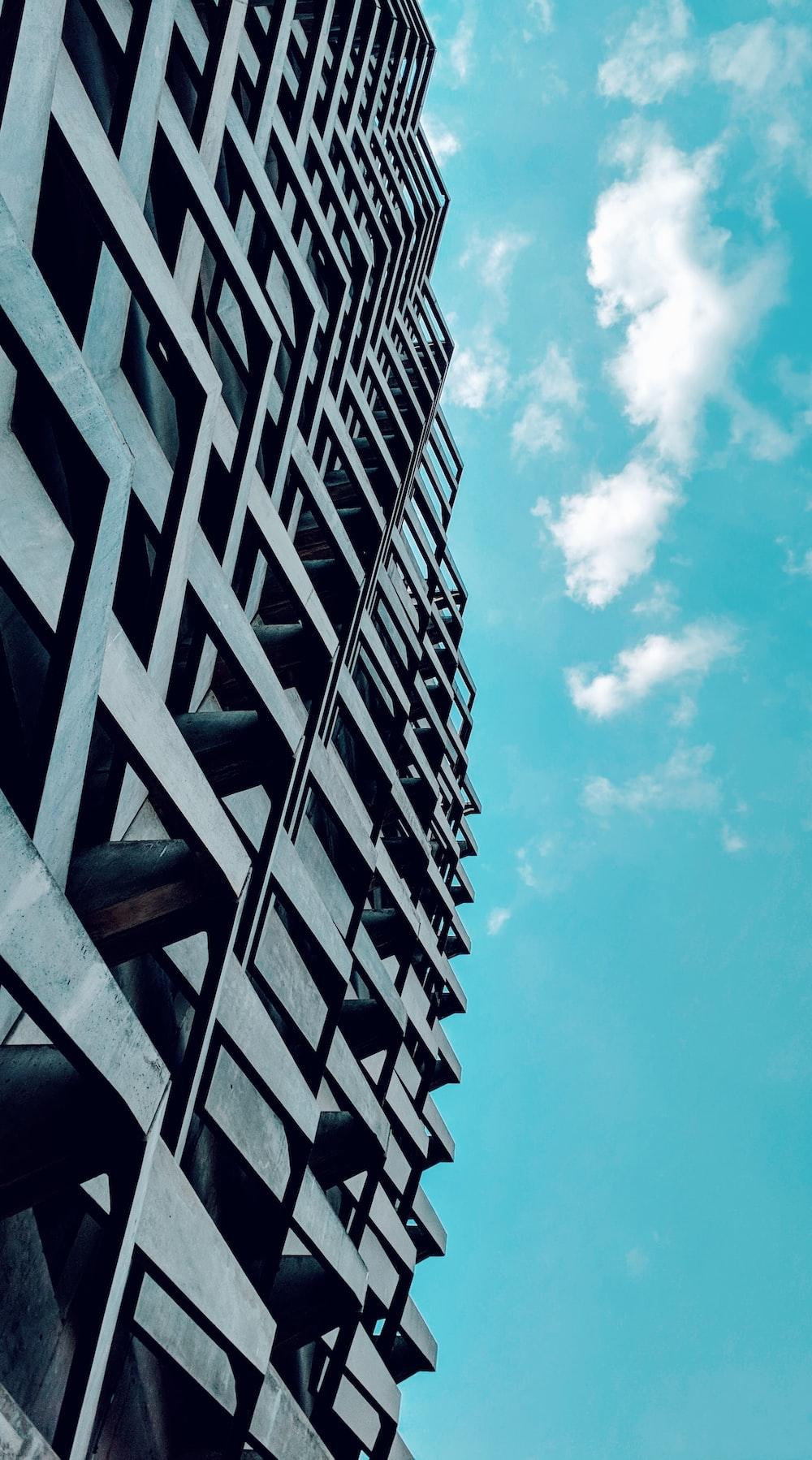 grey multi-storey building under blue sky