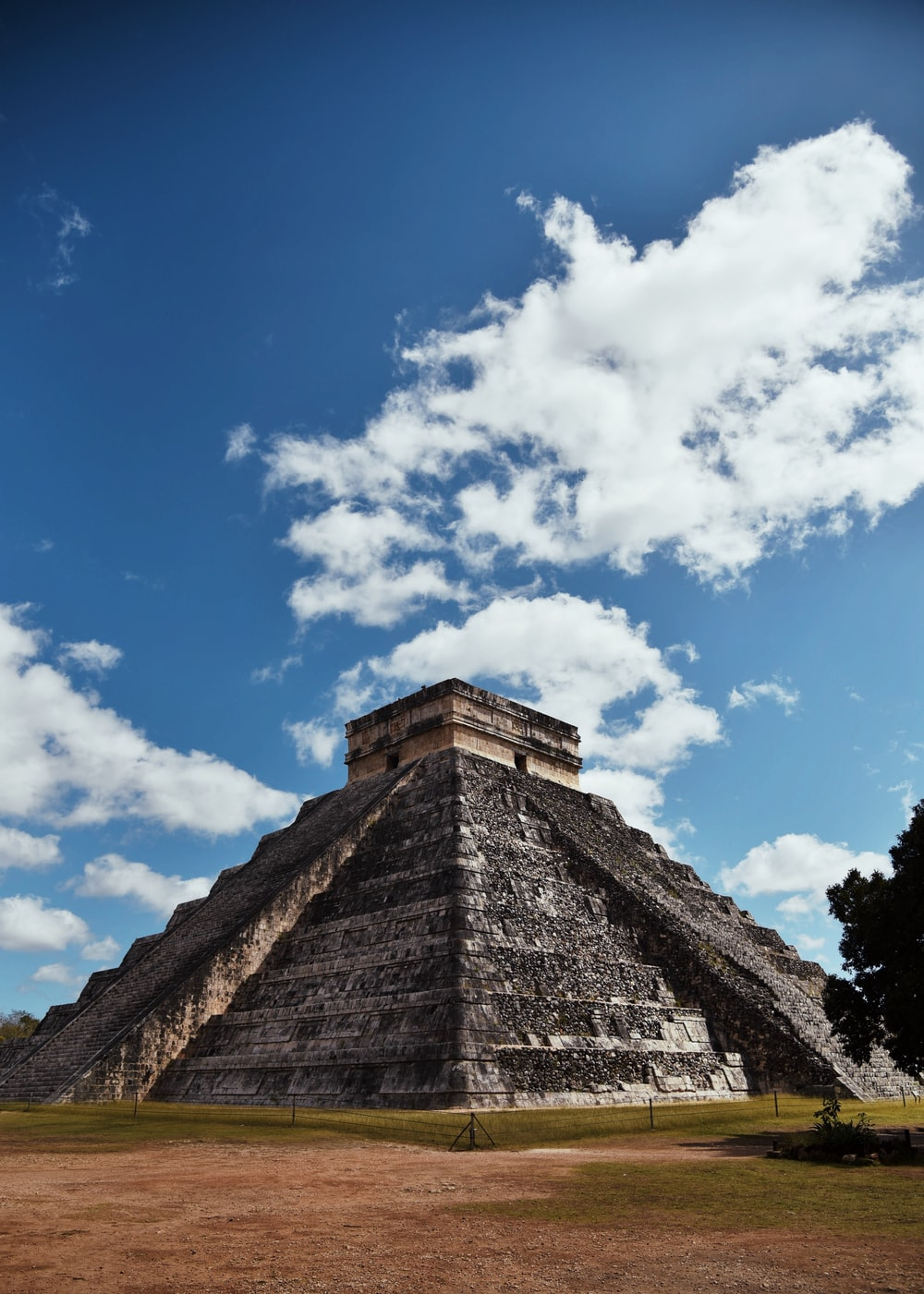grey pyramid under blue and white sky during daytime