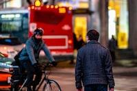 man riding on bike crossing road