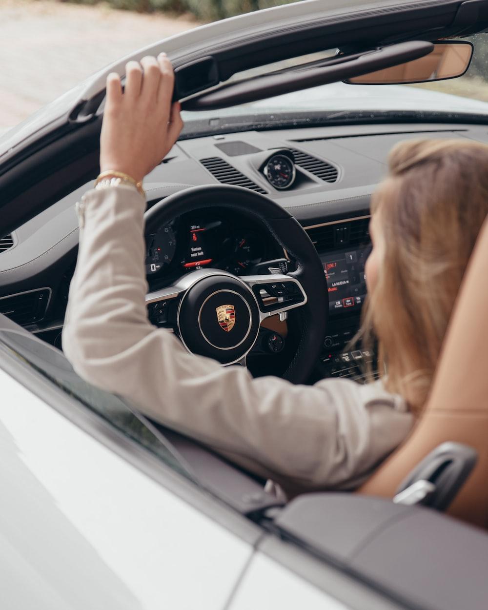 woman driving Cadillac vehicle