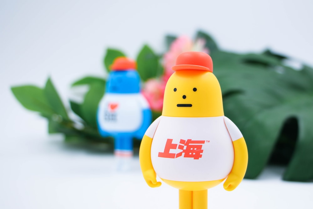 yellow character standing wearing red cap illustration