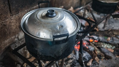gray stainless steel cooking pot close-up photo dutch colonial zoom background