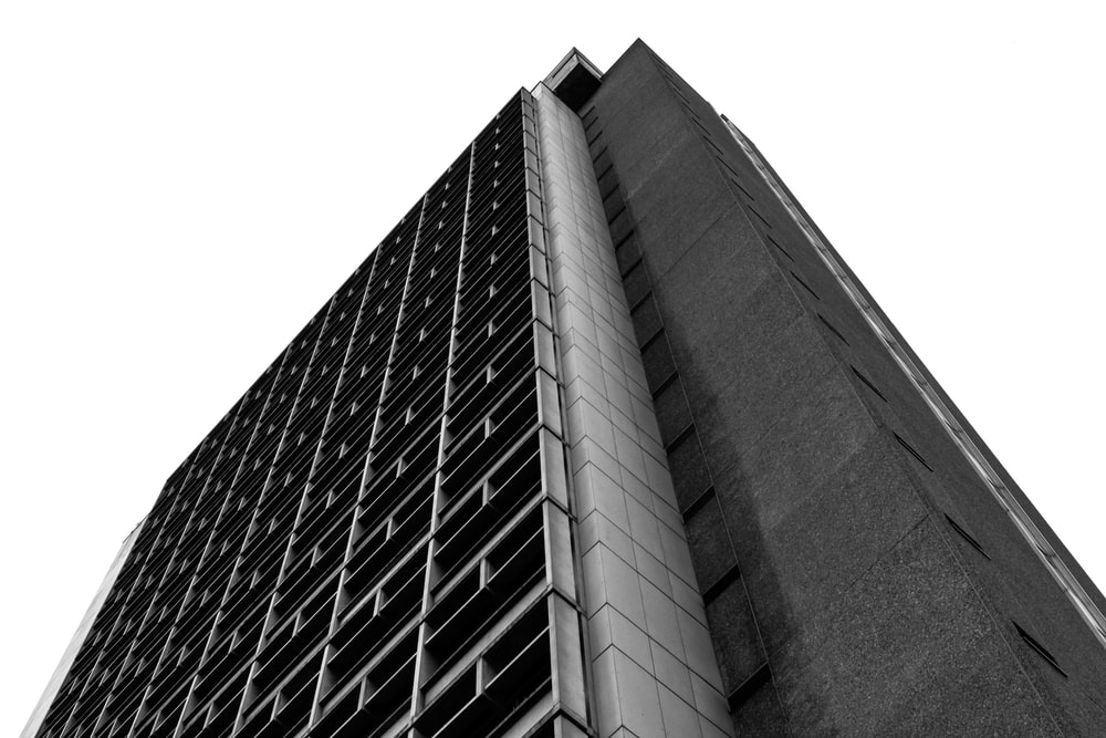 high-rise building grayscale low-angle photography