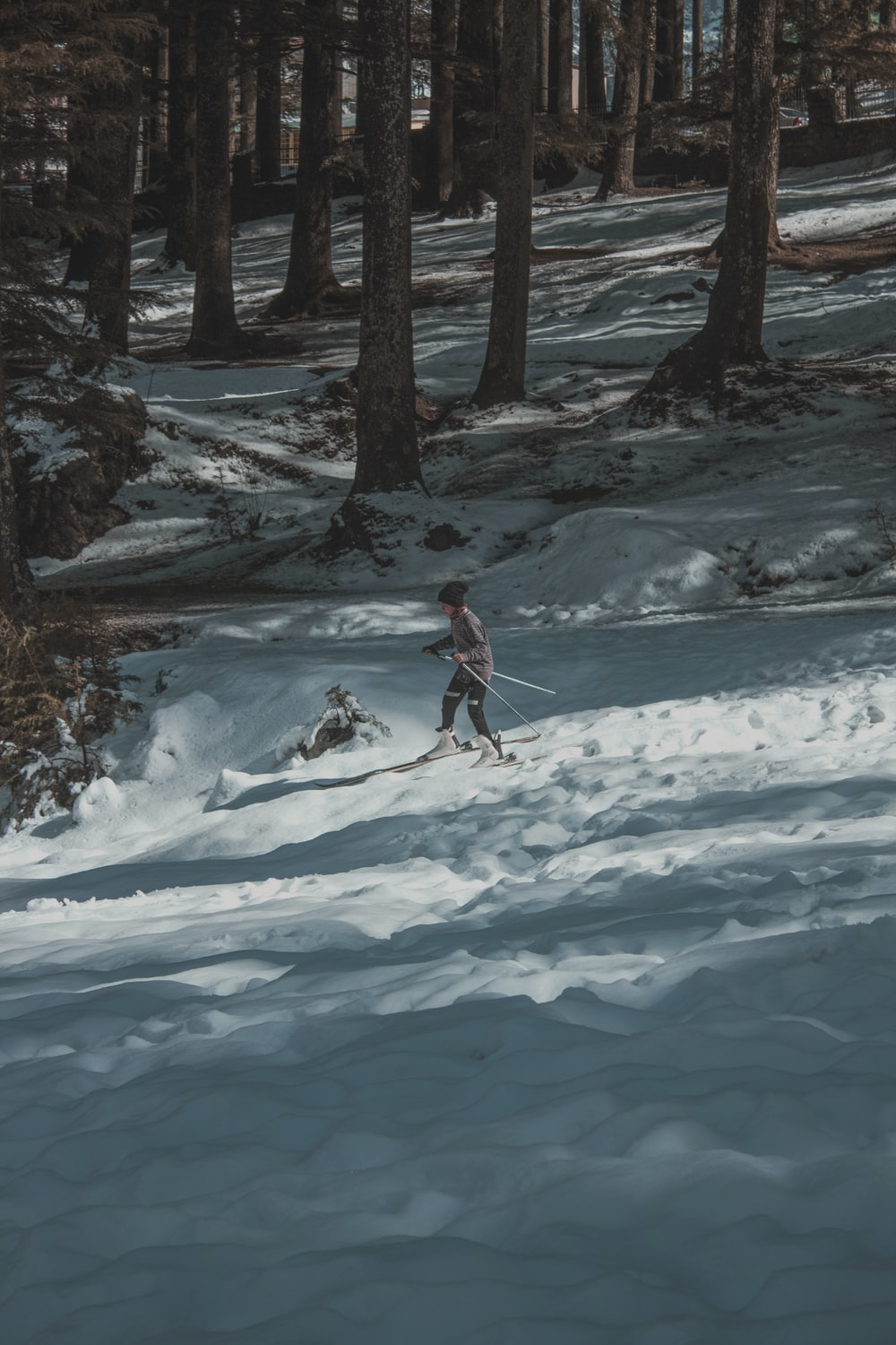 woman skiing on snow near woods