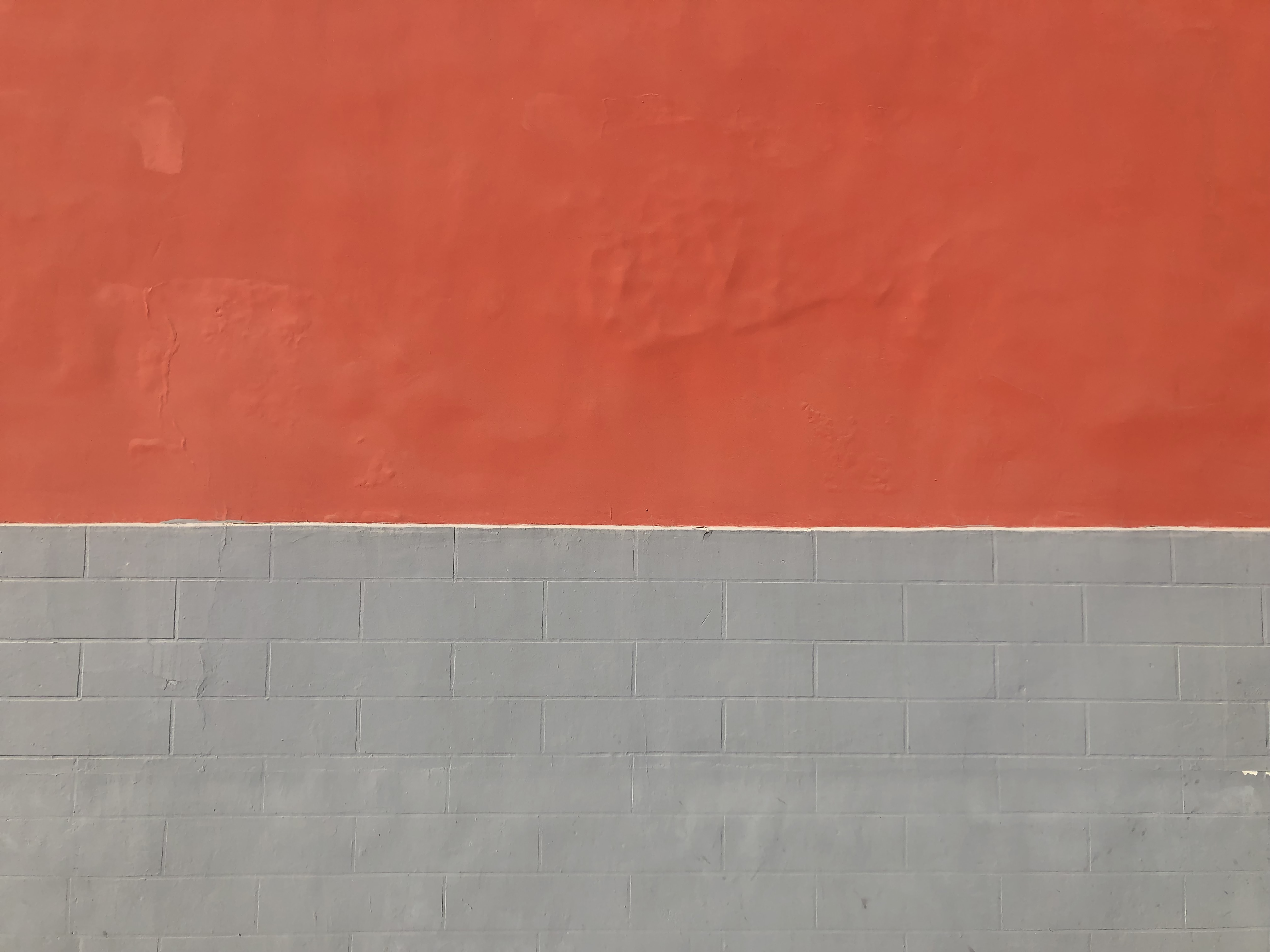 gray and orange painted wall