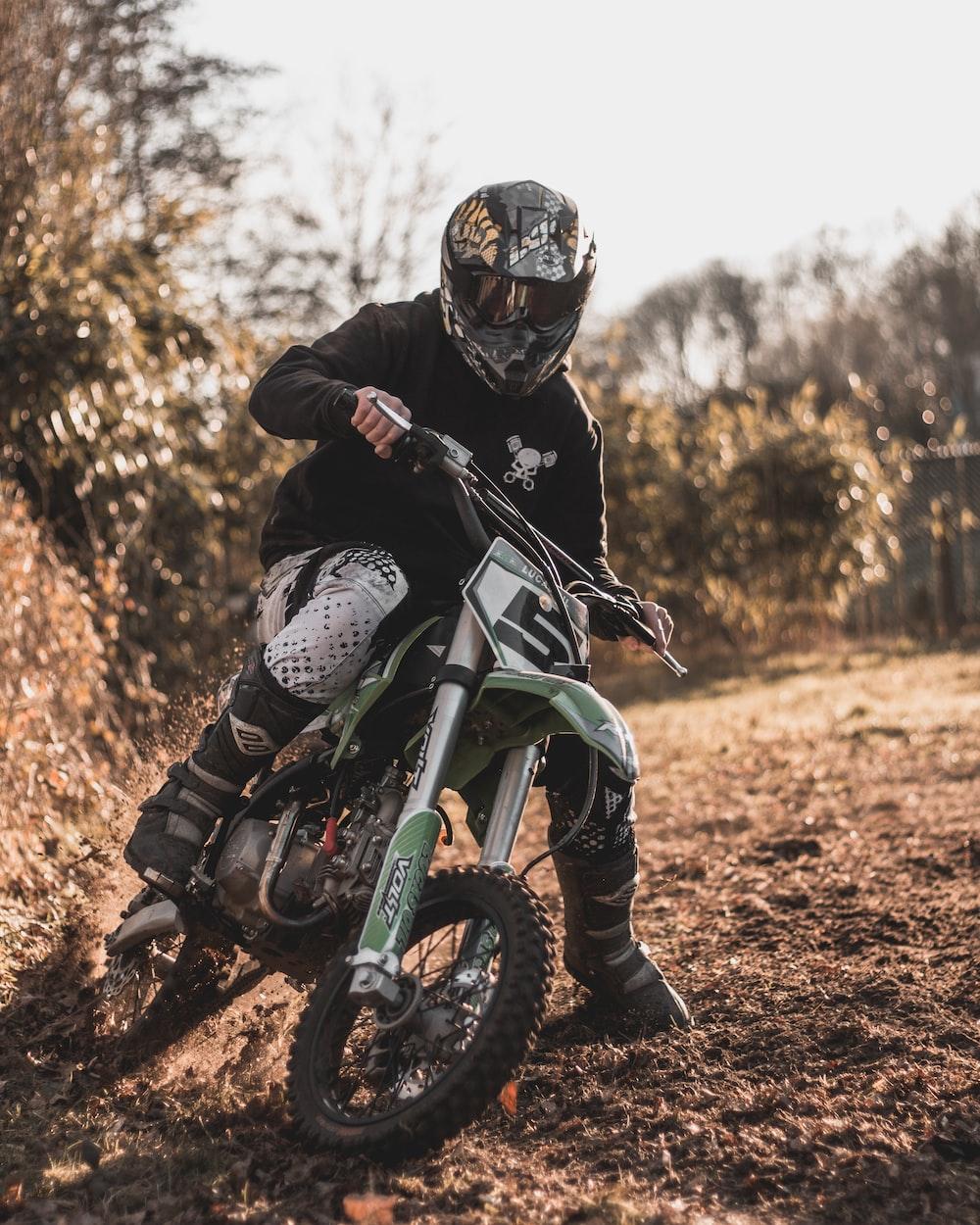 man riding dirt bike during daytime