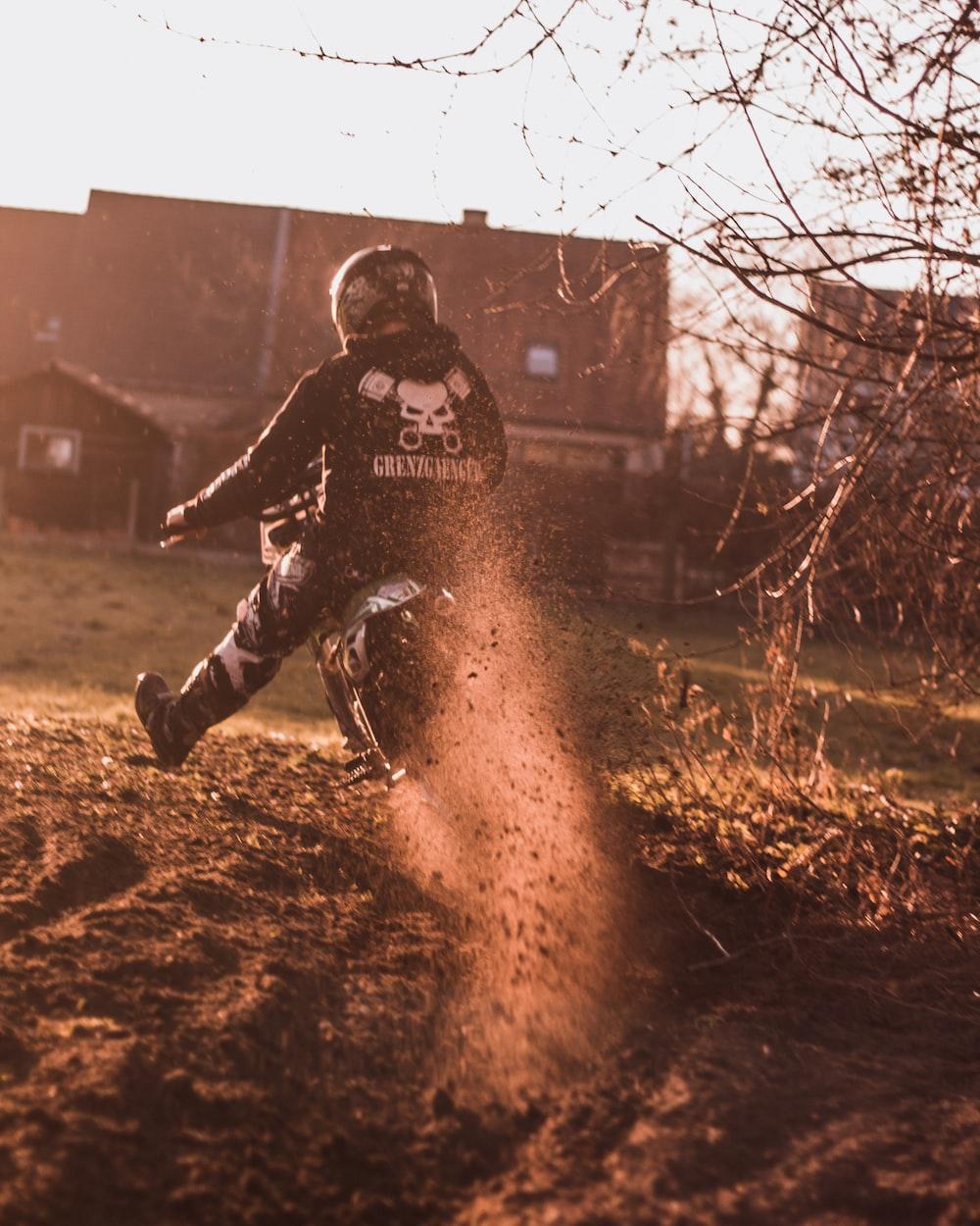 person riding dirt bike during daytime