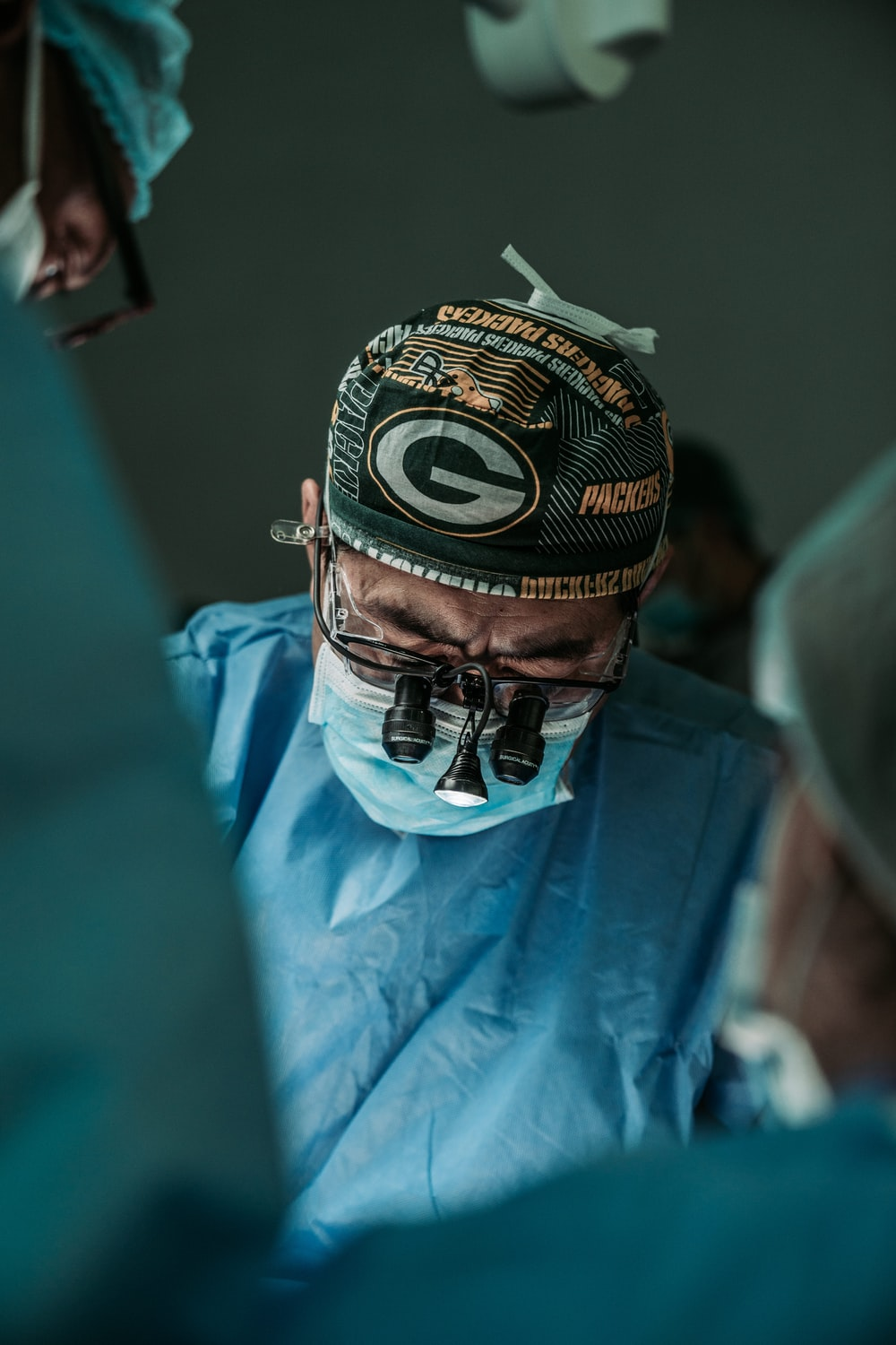 doctor wearing Green Bay Packers hat