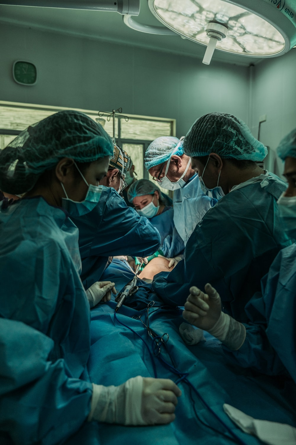 doctor performing operation