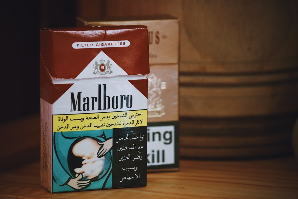 Marlboro flip-top cigarette box on wooden surface