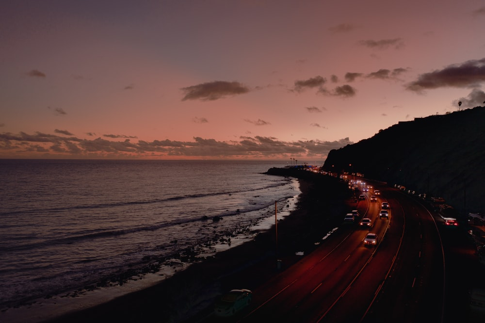 view of road with vehicles near coastline