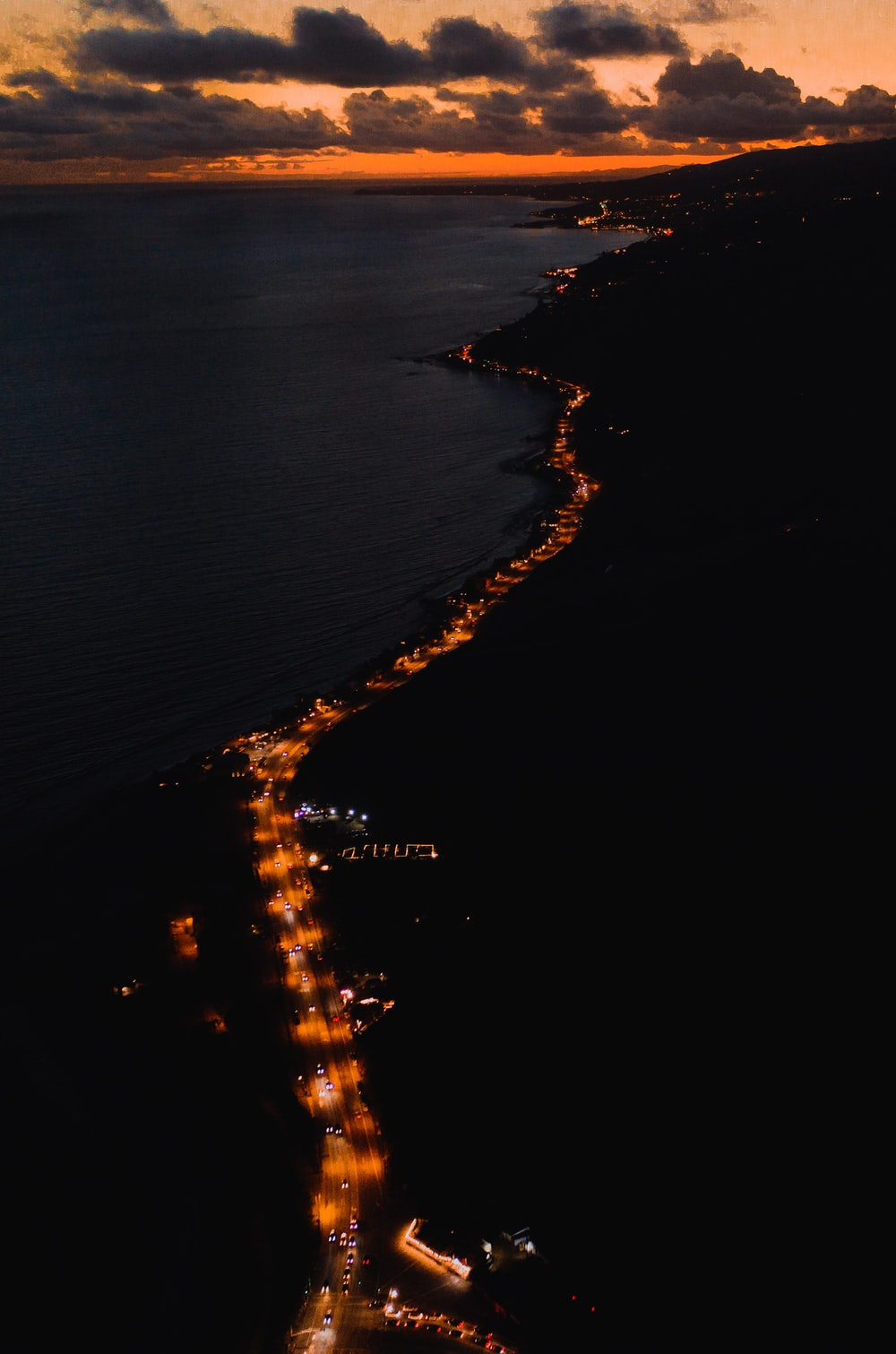 aerial photography of road beside water