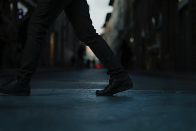 person walking down the road