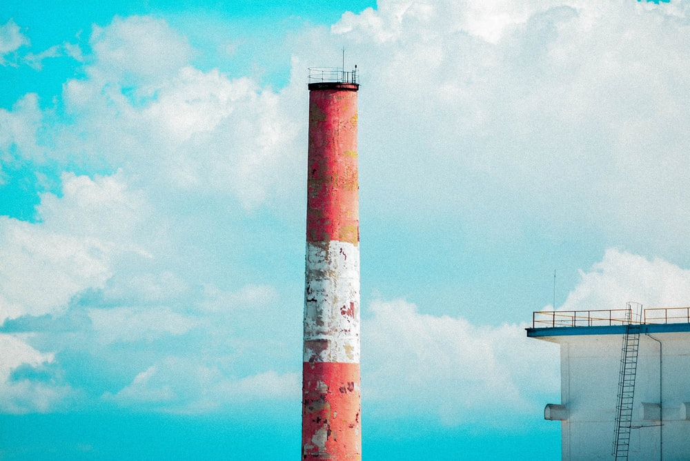 red concrete tower under white clouds during daytime