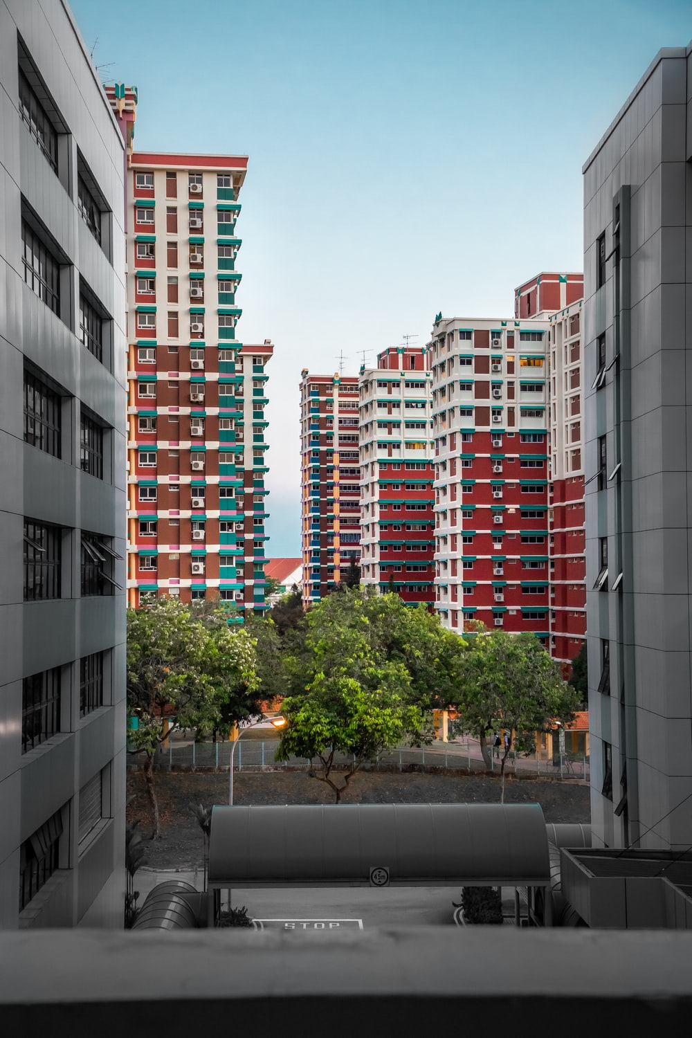 red and gray high-rise buildings
