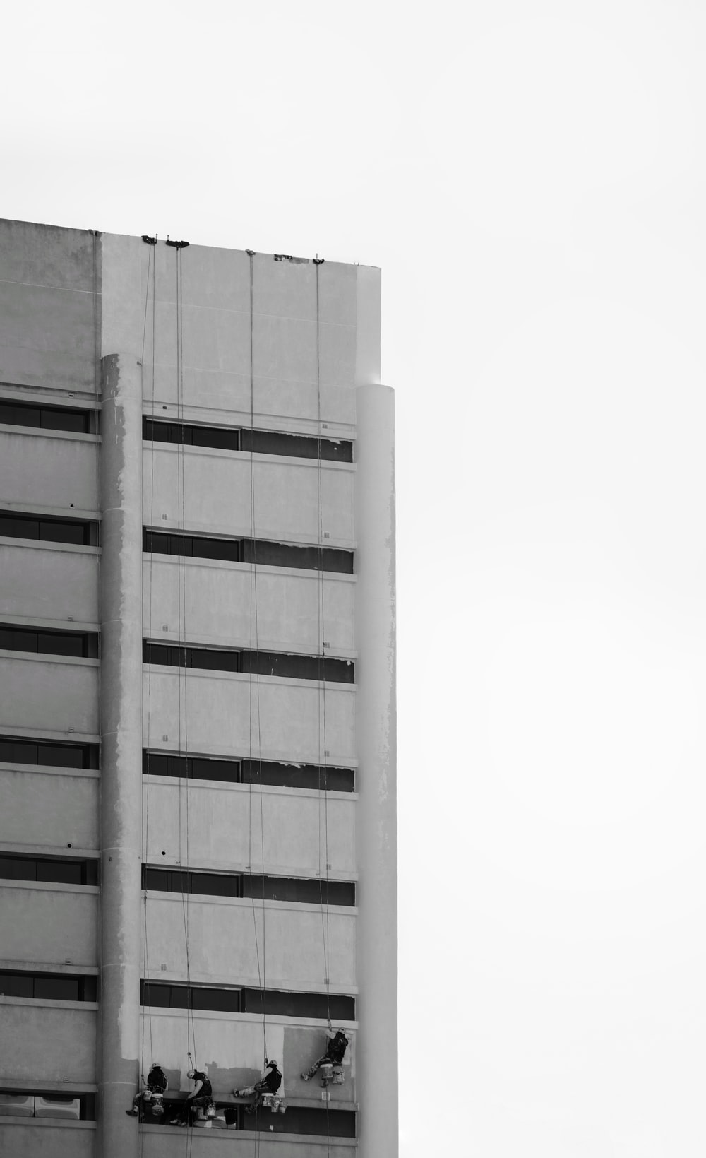 grayscale photography of white concrete building