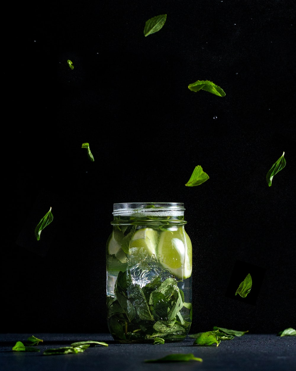 sliced lime in clear glass jar