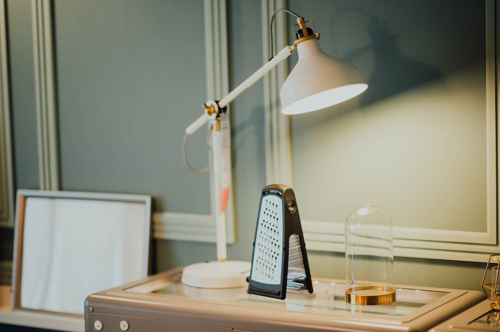 white table lamp on brown wooden desk
