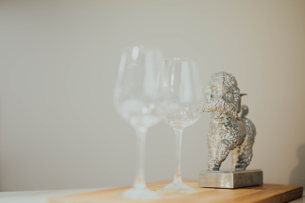 selective focus photography of long stem wine glasses on table