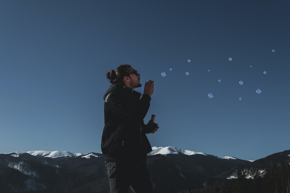 man playing with bubbles