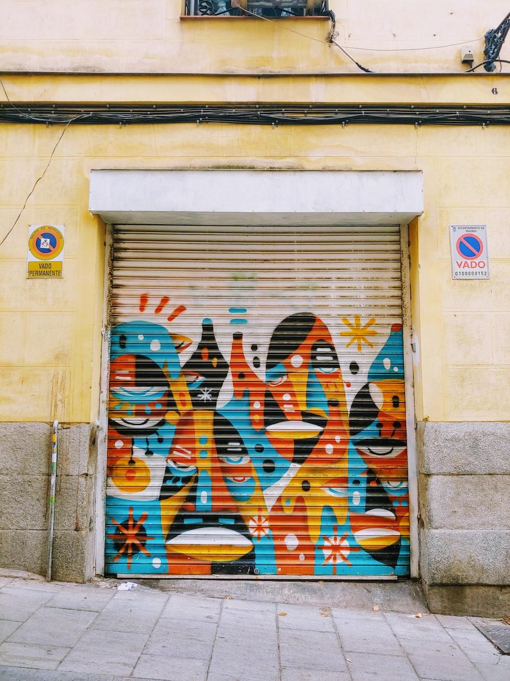 multicolored mural roll-up door