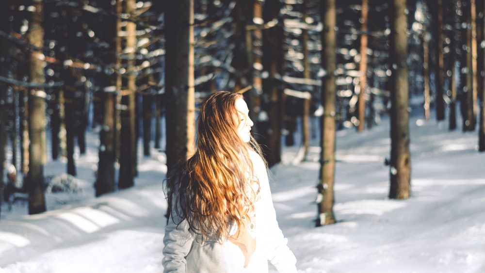 woman standing near forest